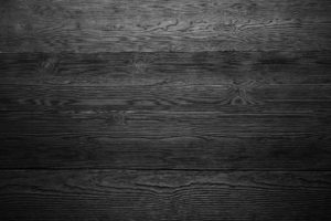 Dark wood background in black and white. Close up of wall made of wooden planks